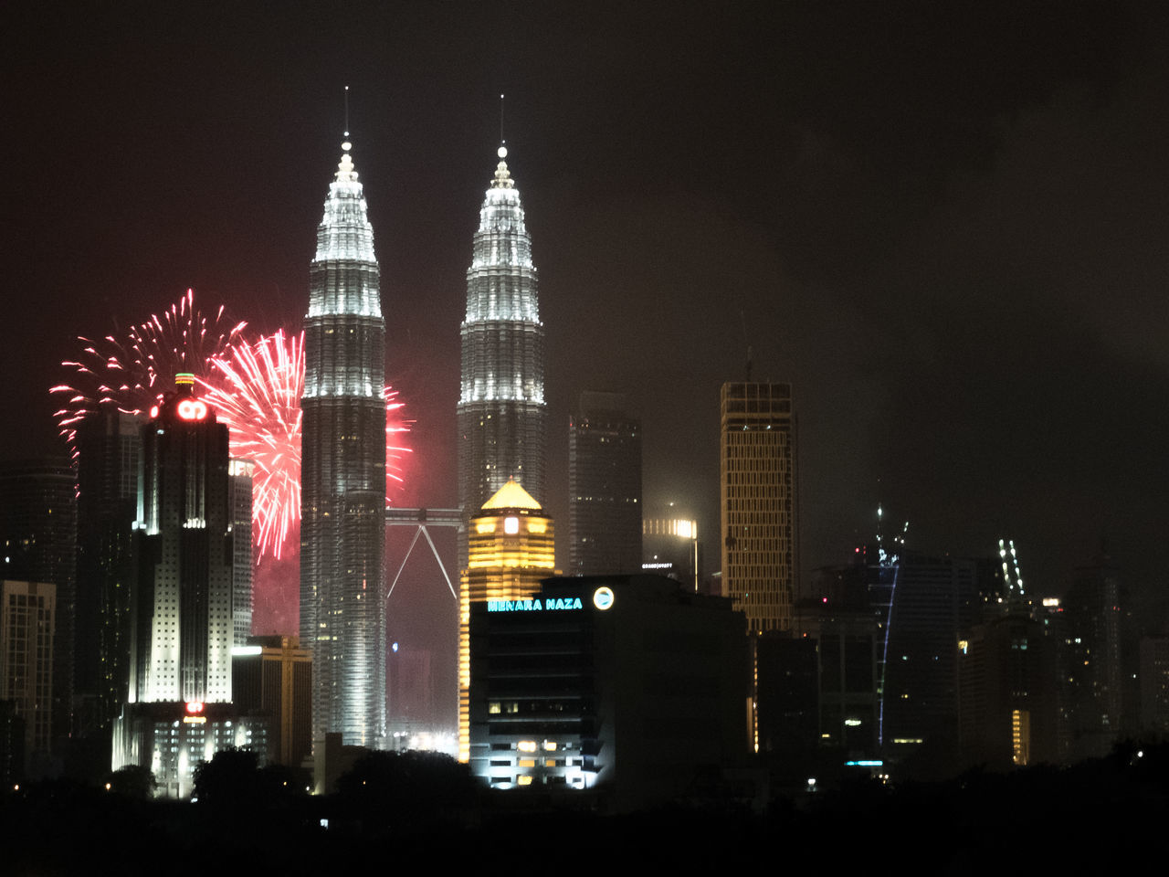 architecture, building exterior, illuminated, built structure, night, tall - high, travel destinations, skyscraper, modern, city, sky, no people, outdoors, low angle view, cityscape