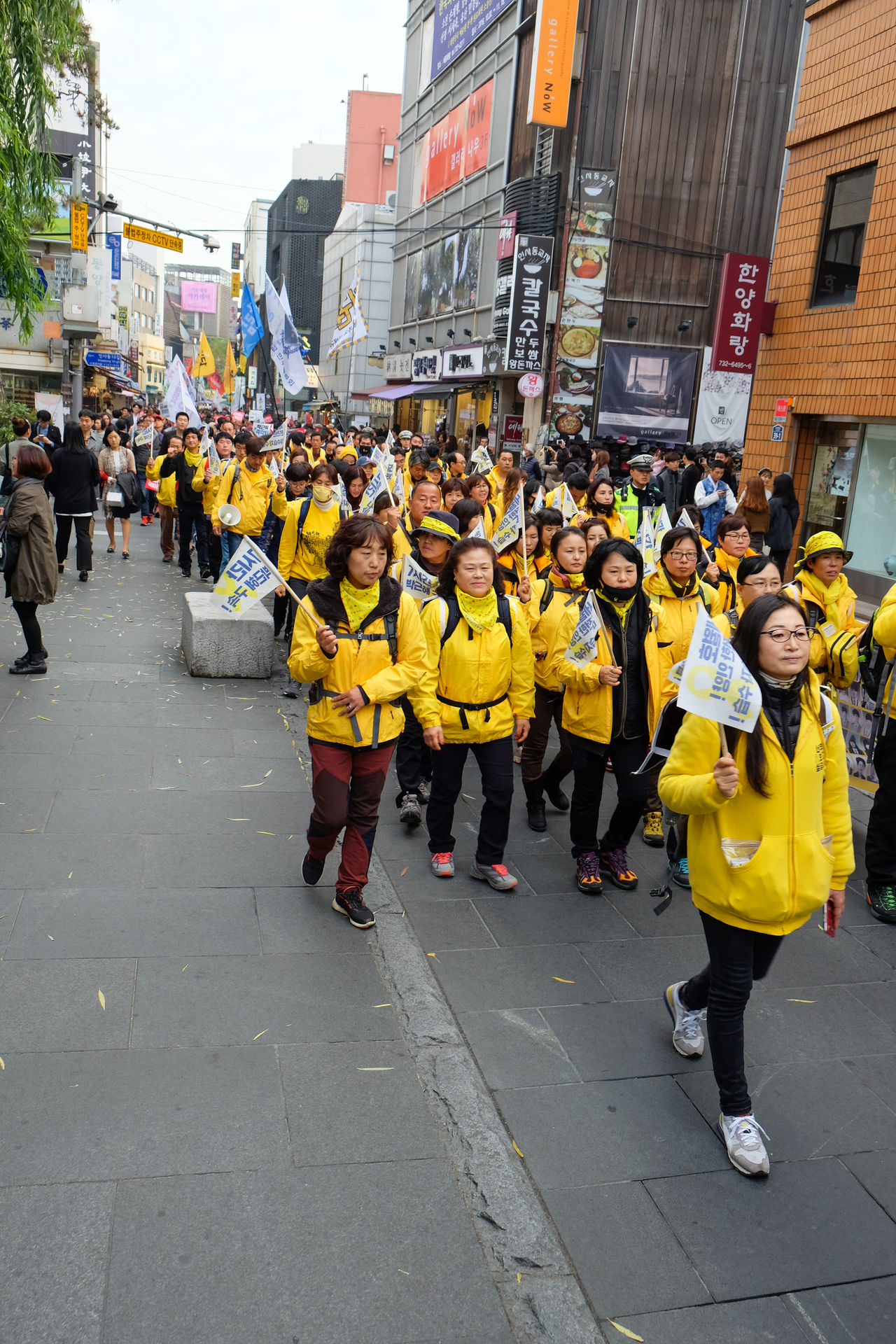A group of Korean Presidential Protesters at a Seoul shopping street. Adult City Crowd Day Korean Large Group Of People Marching Outdoors People Protest Protesters Protestor Real People Reflective Clothing Riot Street Togetherness Uniform Unity Yellow The Photojournalist - 2017 EyeEm Awards