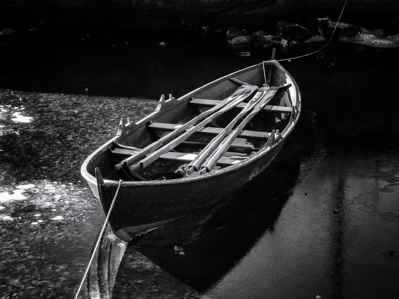 High Angle View Of Boat Moored At Riverbank During Winter
