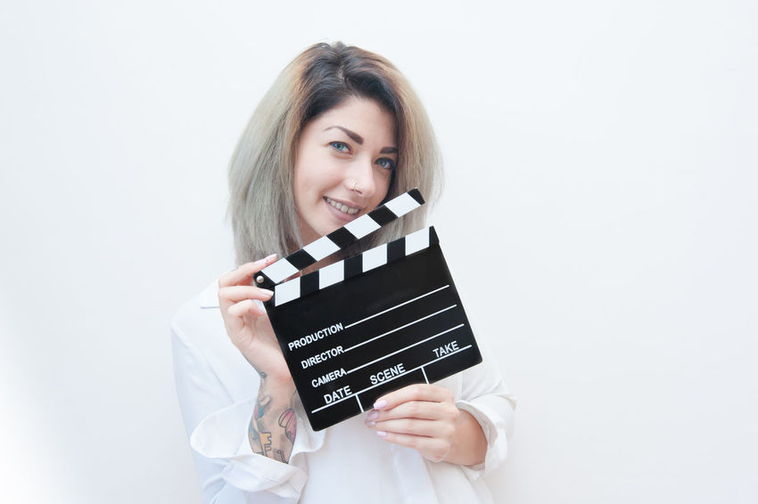 Young pretty woman with movie clapperboard Actress Audition Blonde Blue Eyes Cinema Clapper Film Film Photography MOVIE Pretty Slate Smile Woman Young