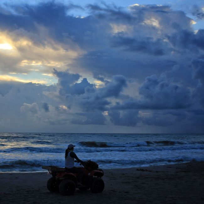Life guard cruising the beach Life Guard Life Guard On Duty Four Wheeler Four Wheeling Melbourne Beach, FL Transportation Beach Horizon Over Water Land Vehicle Mode Of Transport Cloud - Sky Oceanscape Storm Clouds Sunrise And Clouds Sunrise_Collection
