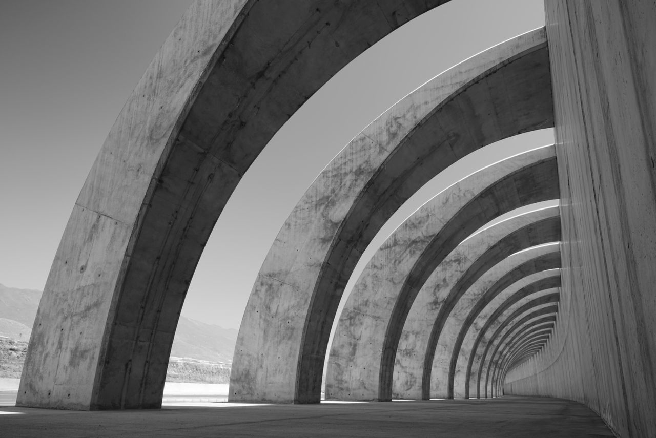 Built Structure Bridge - Man Made Structure Travel Destinations Architectural Column Curve Day No People Sky The Way Forward Black And White Photography Sony Sea Monocromatic