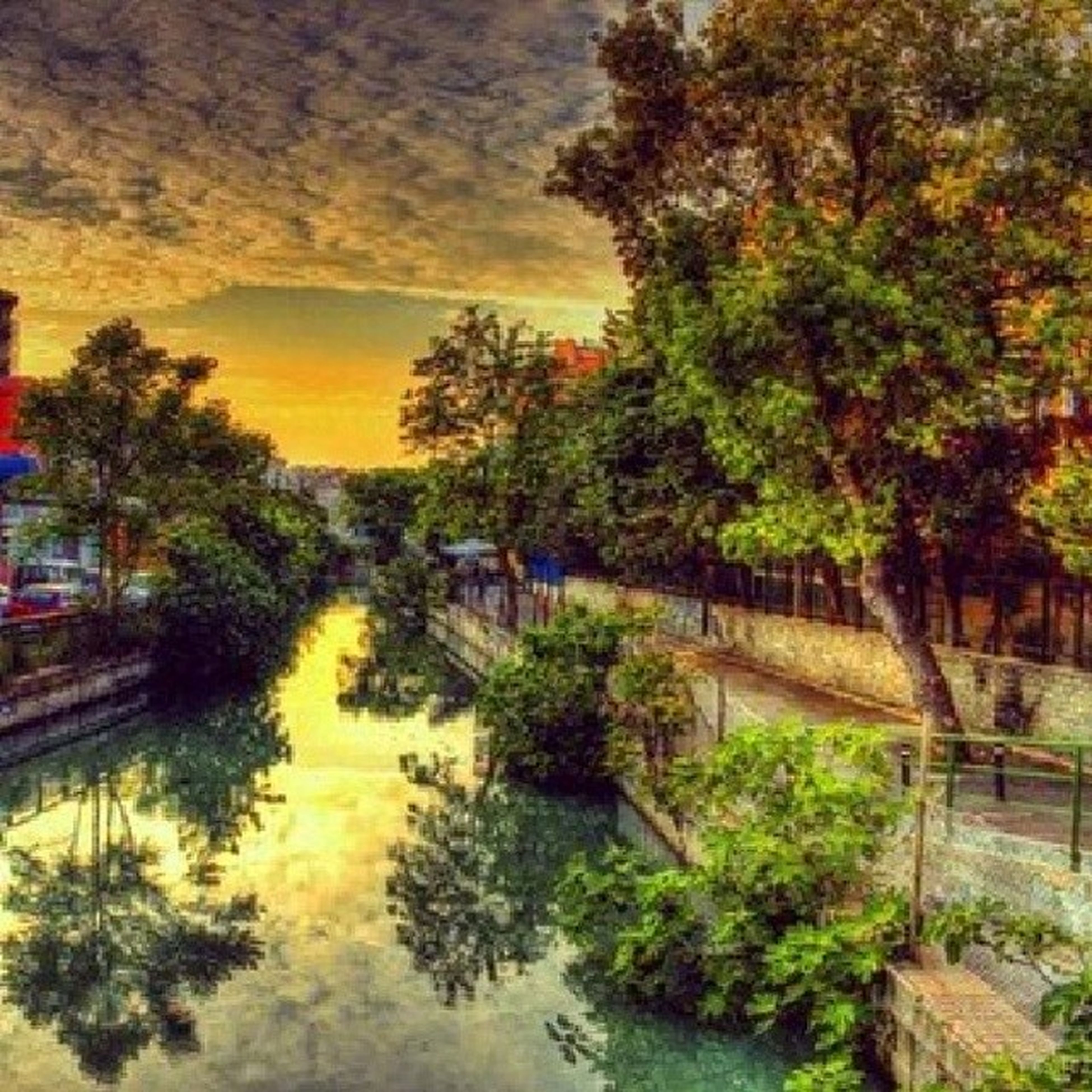 tree, water, reflection, sunset, sky, tranquility, growth, tranquil scene, beauty in nature, nature, waterfront, scenics, lake, river, built structure, canal, cloud - sky, idyllic, architecture, pond