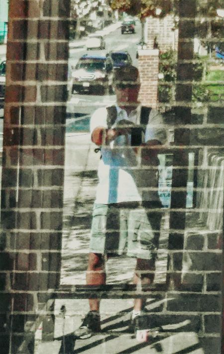 The craziest reflection! Bus stop thing with two pieces of glass in front of a brick wall...you can see the bricks through me😎 No Double Exposure Smoking Reflection Taking Photos Selfie ✌ Enjoying Life Sunglasses Sunlight Glass Art Brick Wall