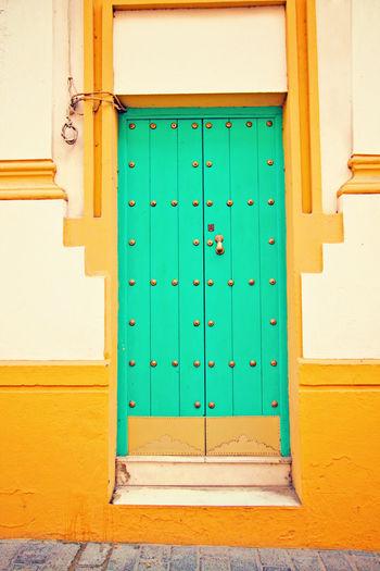 Blue Door SPAIN Seville Travel Travel Photography Turquoise Colored Architecture Blue Blue Green  Building Exterior Closed Door Door Doorway Green Door No People Old Door Turquoise Turquoise Door Yellow