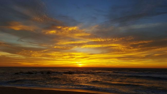 Sunset over the sea Sea Water Horizon Over Water Sunset Scenics Tranquil Scene Tranquility Beauty In Nature Idyllic Beach Nature Sky Orange Color Calm Cloud - Sky Seascape Waterfront Cloud Dramatic Sky Shore