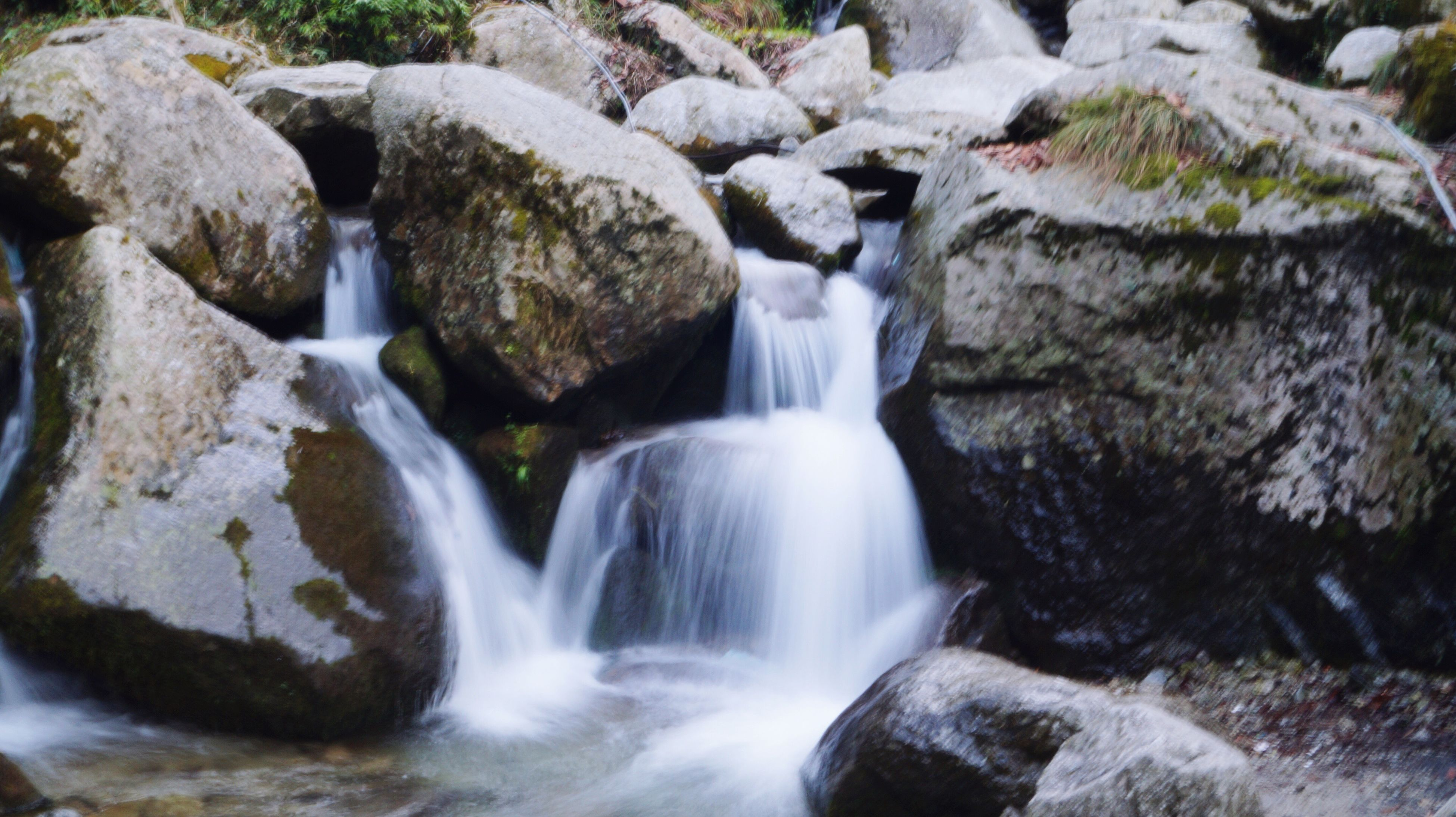waterfall, water, long exposure, flowing, motion, flowing water, scenics, forest, beauty in nature, blurred motion, environment, rock - object, nature, power in nature, non-urban scene, purity, moss, day, rock formation, rock, tranquil scene, waterfront, outdoors, natural landmark, no people, tranquility, non urban scene, remote
