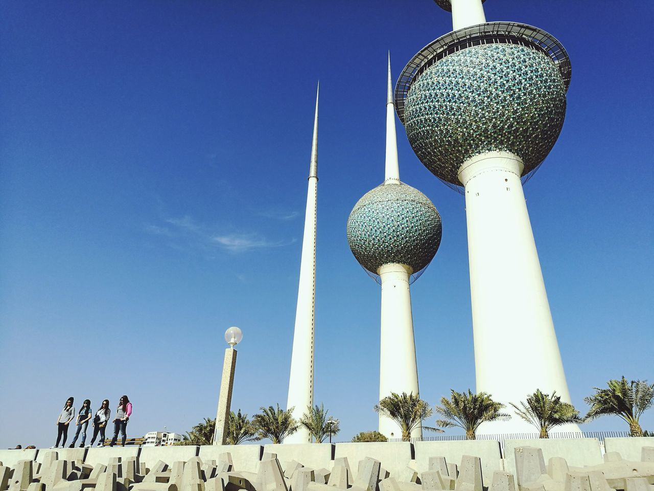 Beautifully Organized Architecture Low Angle View Kuwait Towers Blue Sky Outdoors Day TogethernessVariation Tree Art Young Women Life Style Concrete Structure friendship