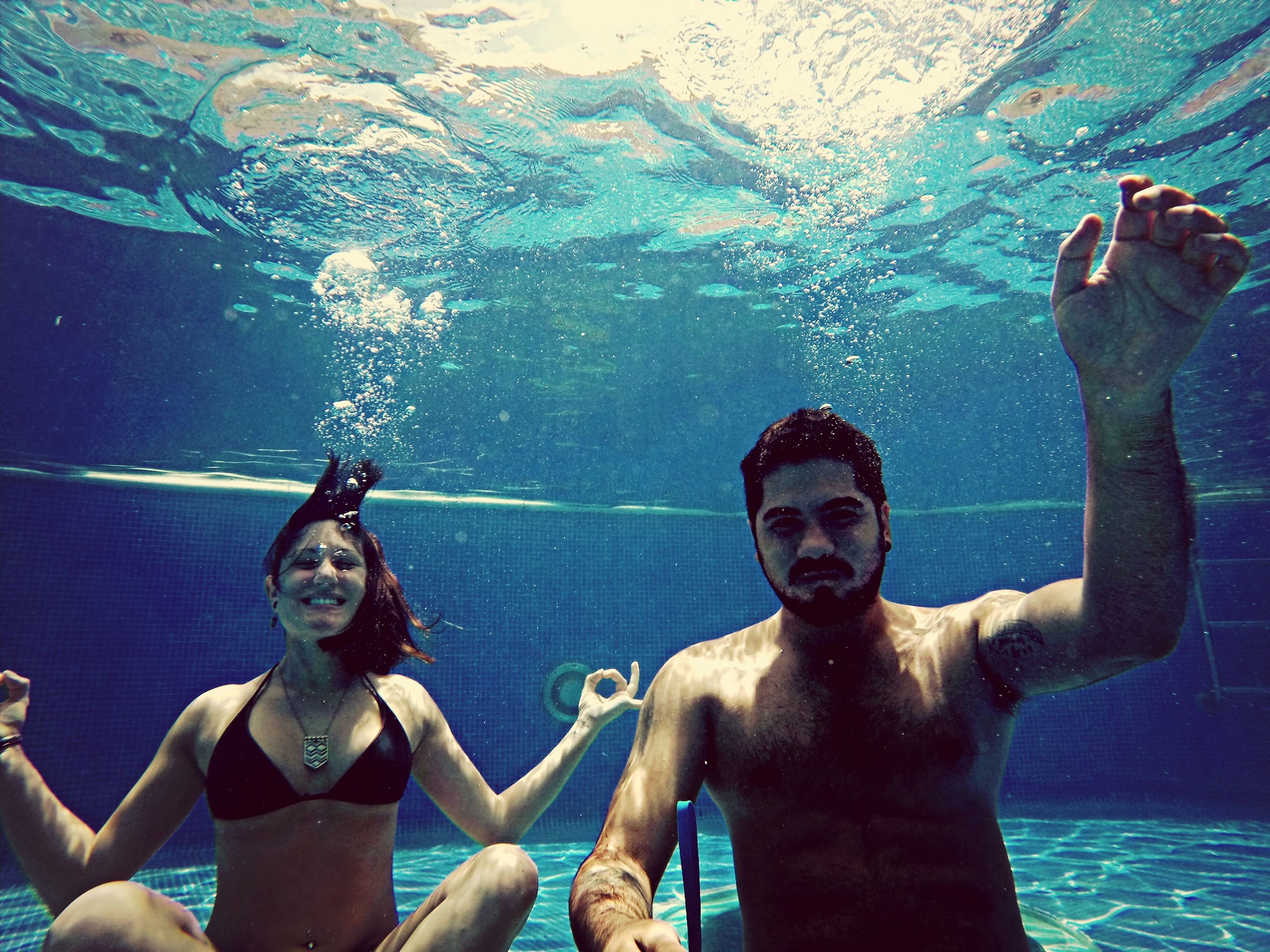 lifestyles, leisure activity, water, togetherness, enjoyment, person, bonding, young adult, young men, fun, happiness, looking at camera, vacations, portrait, swimming pool, smiling, swimming