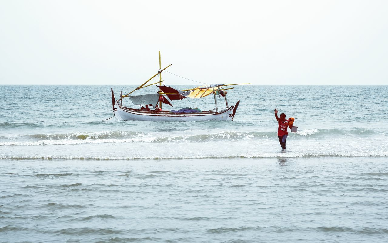 Sea Nautical Vessel Transportation Full Length Fisherman Fishing Net Outdoors Water Sky Day People One Person Nature Adults Only Adult Fishing Boat