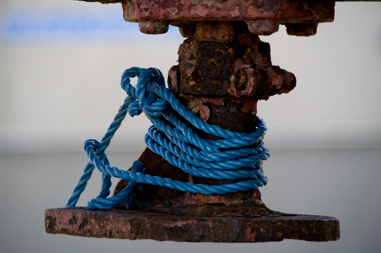 Close-up Of Old Rope On Metal Structure