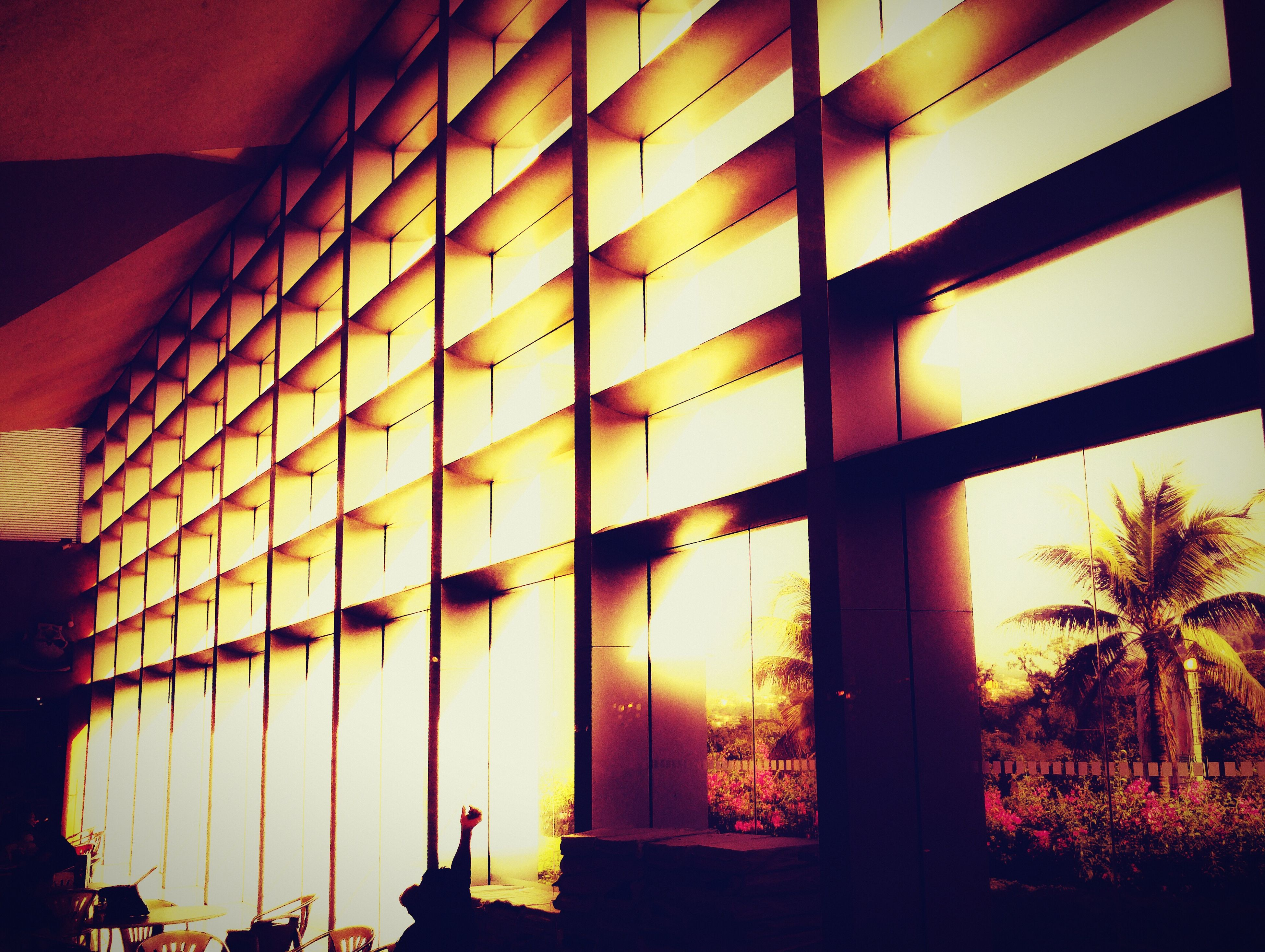 architecture, built structure, sunset, building exterior, window, orange color, illuminated, low angle view, sunlight, indoors, sun, building, house, no people, glass - material, sunbeam, lens flare, residential structure, residential building