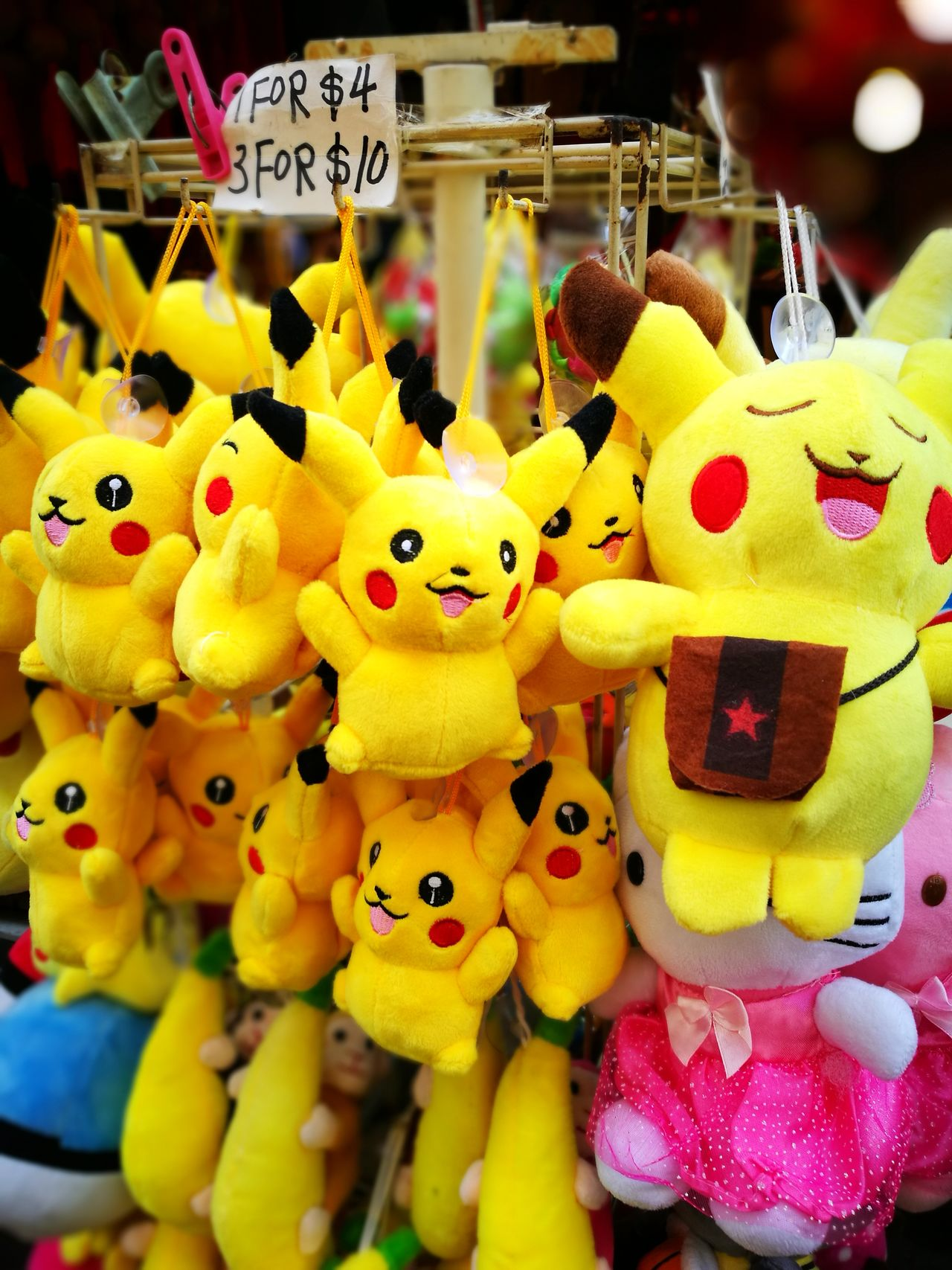 Animal Representation Toy For Sale Choice Yellow Retail  No People Artificial Hanging Variation Stuffed Toy Market Indoors  Close-up Day Pikachu Happy Street Photography The Week Of Eyeem