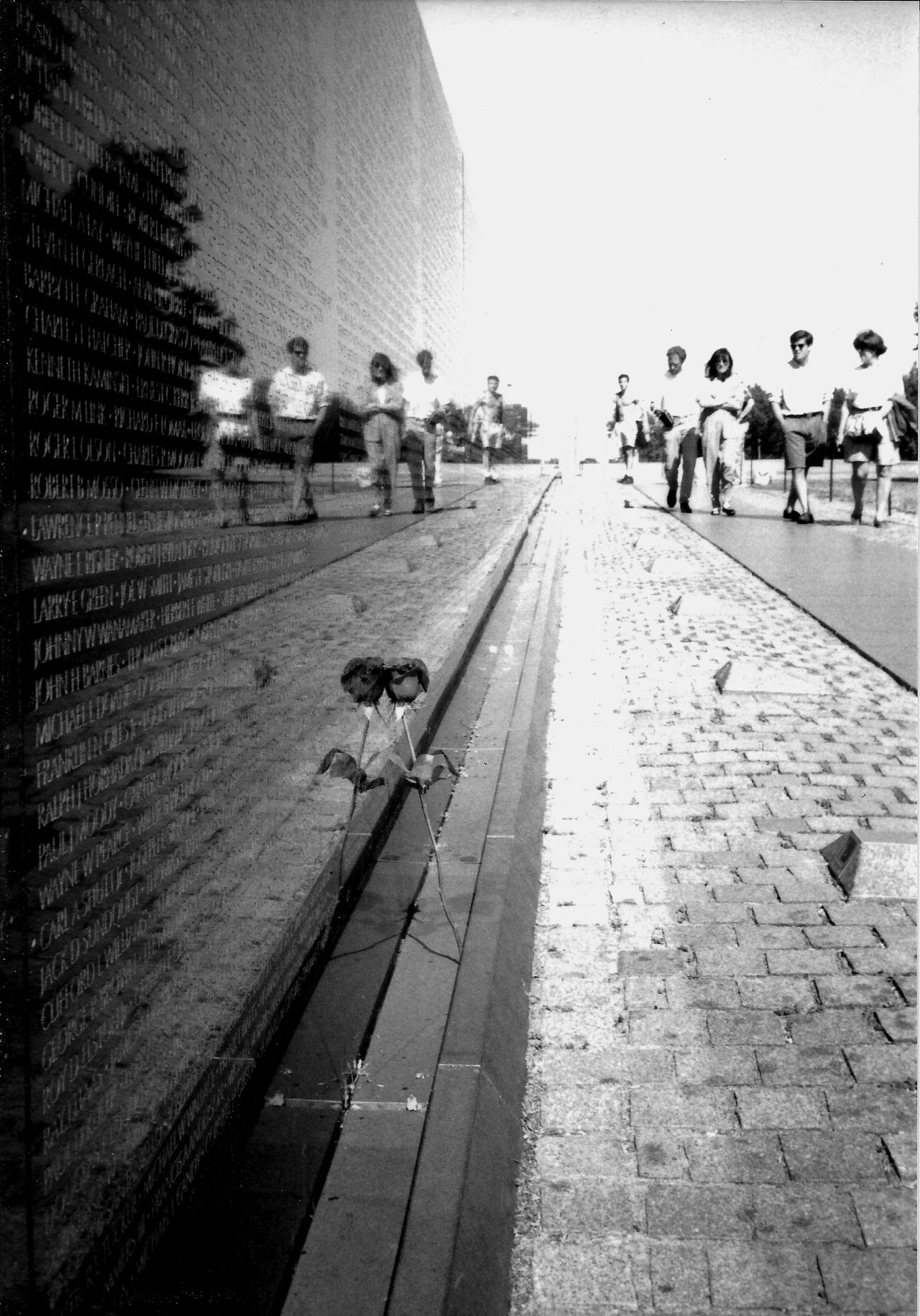 sombre 35mm Film Analogue Photography B&w Street Photography Capital Cities  Diminishing Perspective Everybodystreet Film Photography Filmisnotdead Fine Art Photography In Loving Memory National Park Reflection Single Rose Sombre Mood Street Photography Symmetry Tourism Tourist Attraction  Urban Geometry Urban Landscape Vanishing Point Vietnam War Memorial Washington DC Low Angle Perspective