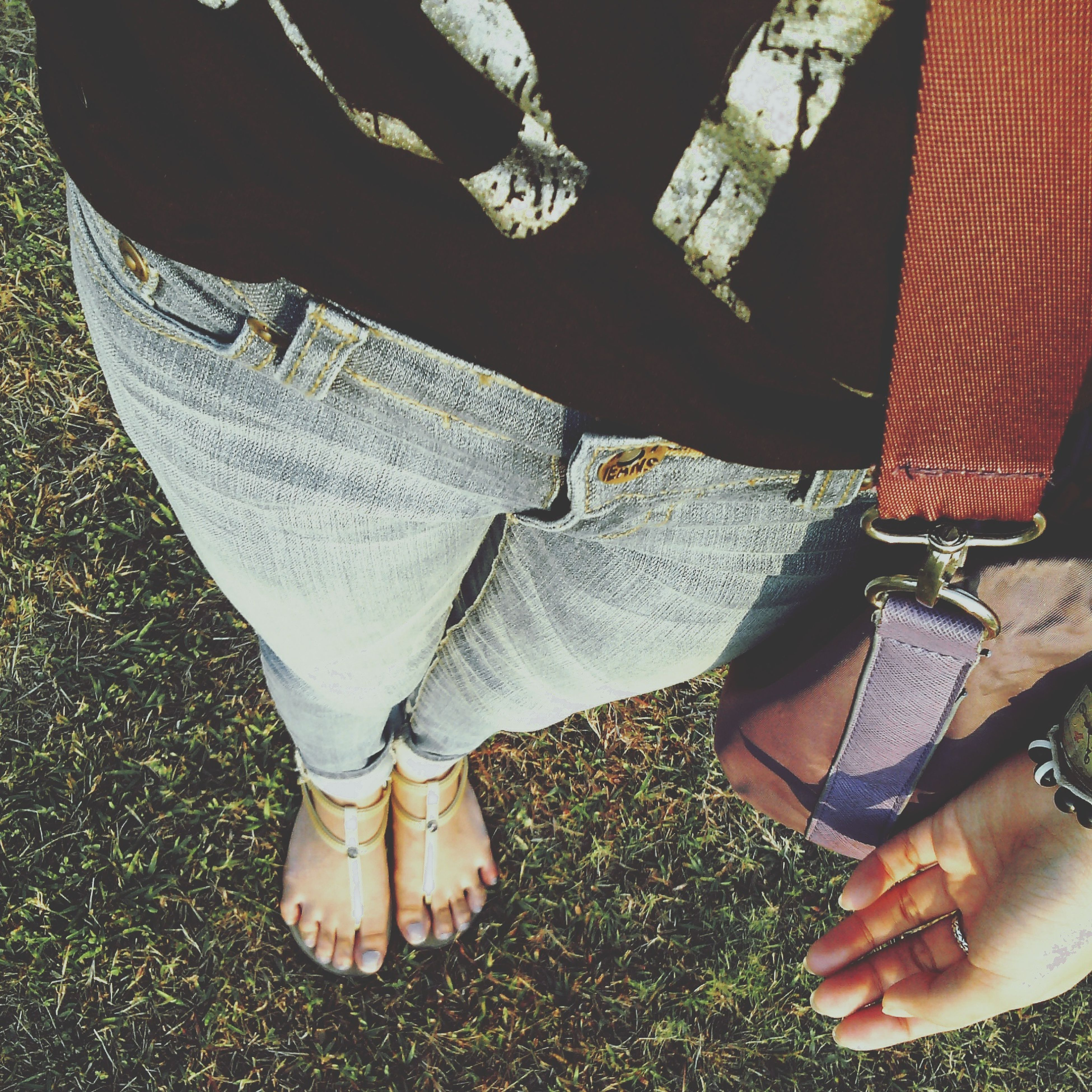 low section, person, lifestyles, leisure activity, shoe, sitting, high angle view, standing, human foot, personal perspective, relaxation, casual clothing, footwear, men, part of, day