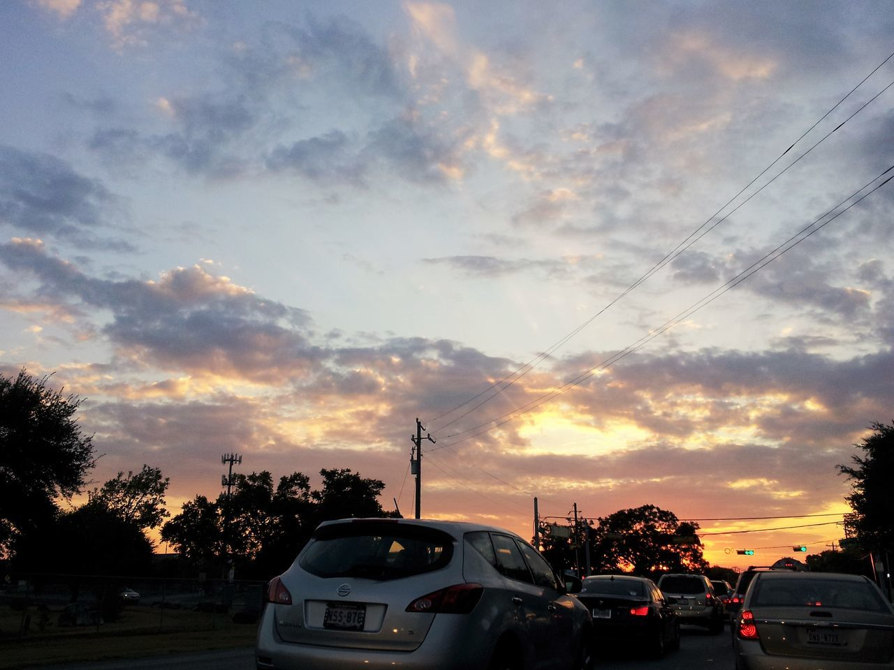 car, sunset, cloud - sky, sky, land vehicle, transportation, mode of transport, tree, outdoors, no people, road, nature, beauty in nature, day