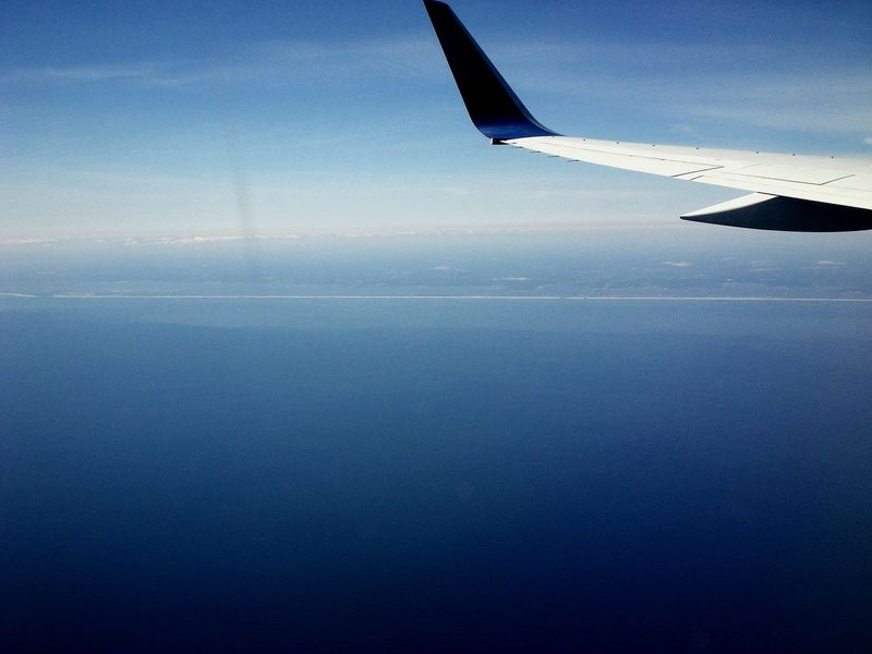 Aerial View Airplane No People Business Finance And Industry Transportation Sky Day Sea Blue Flying Water Horizon Over Water Aerospace Industry Outdoors Aircraft Wing Aircraft In The Sky