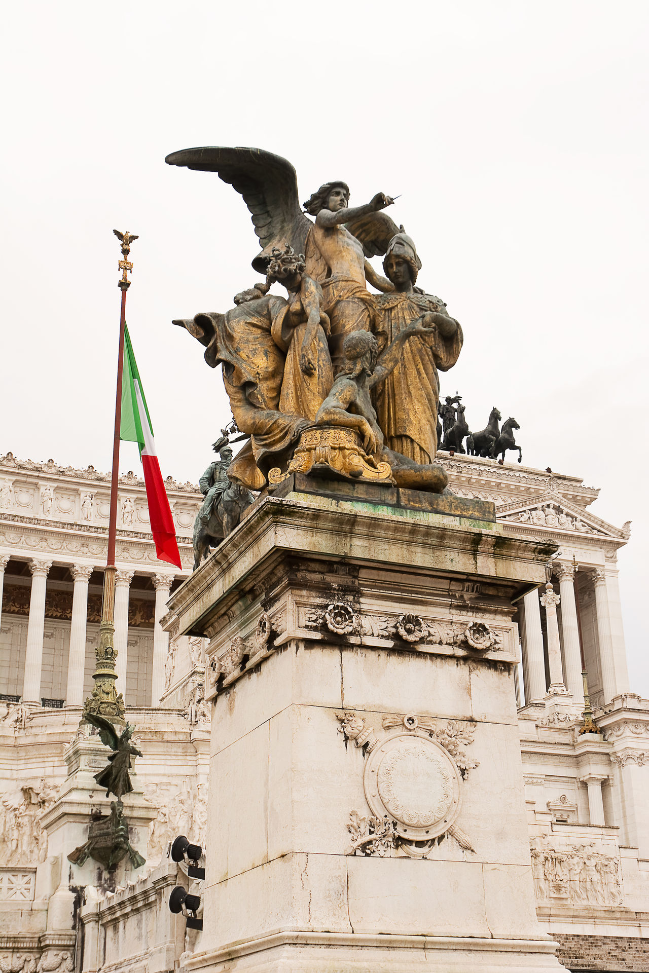 Vittoriano or altar of the fatherland in Venice Square in Rome Altar Angel Capital Capitoline City Emanuel Emanuele Europe Human Representation Italian Italy Landmark Low Angle View Marble Memorial Monument Palace Republic Roma Rome Sculpture Statue Statue