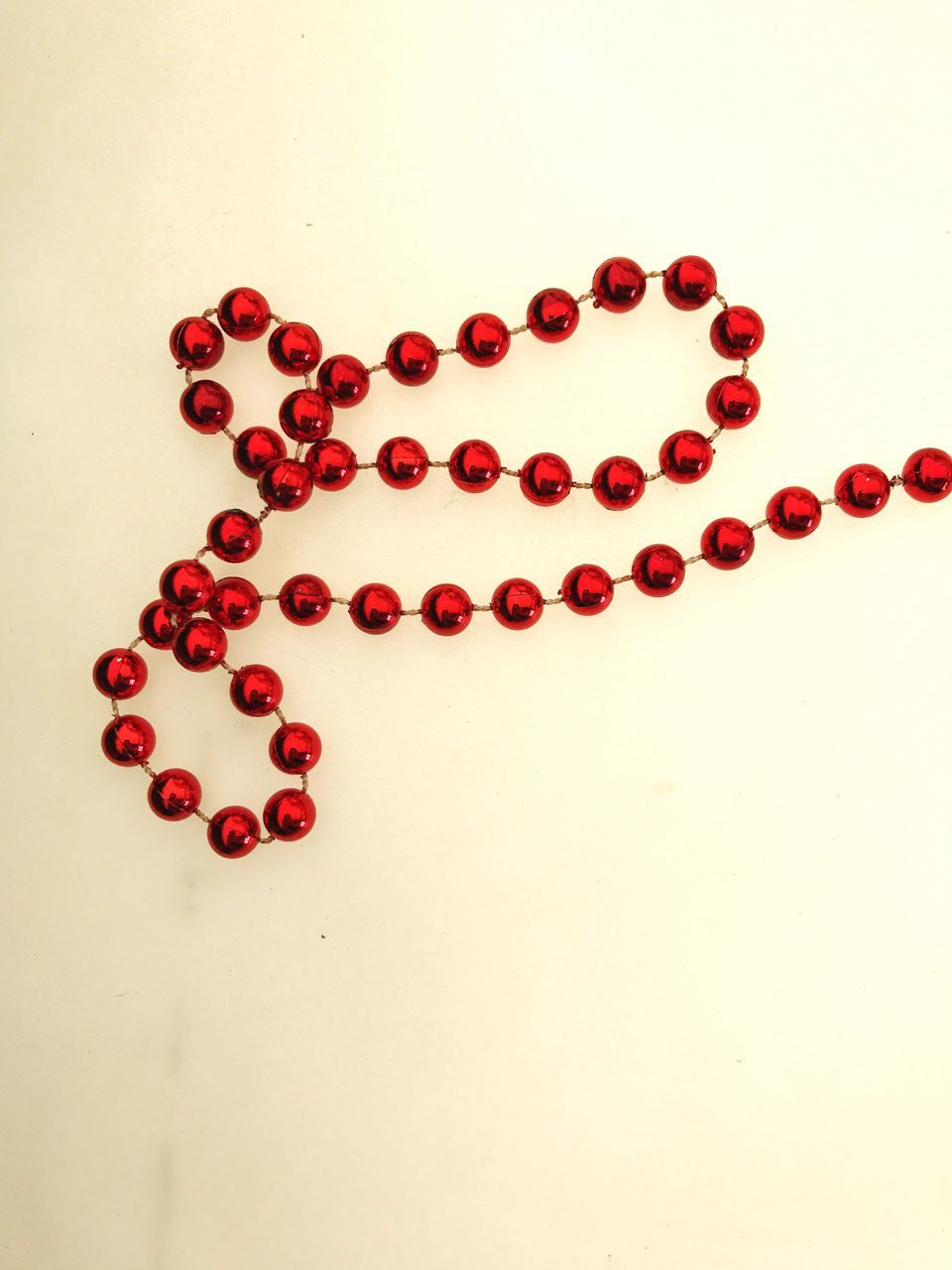Necklace Beads Red Close-up White Background Christmas Decoration No People Studio Shot