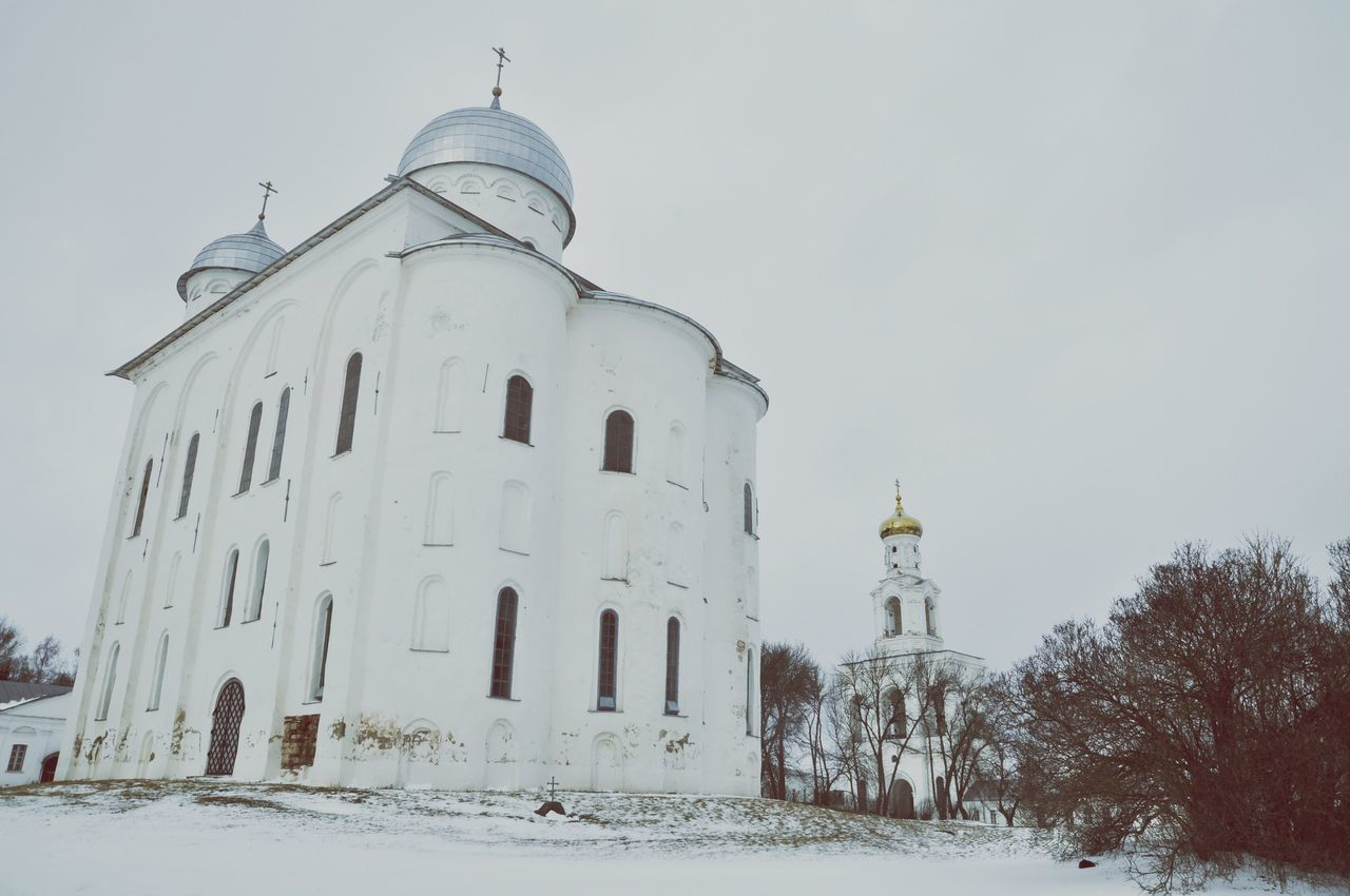 Architecture Built Structure Building Exterior Dome Snow Winter Cold Temperature Low Angle View Sky Arch Outdoors Façade Spire  Place Of Worship History Culture Footpath Famous Place Monument Novgorod Russia Temple Ortodox Church Ortodoxmonastery Snow ❄