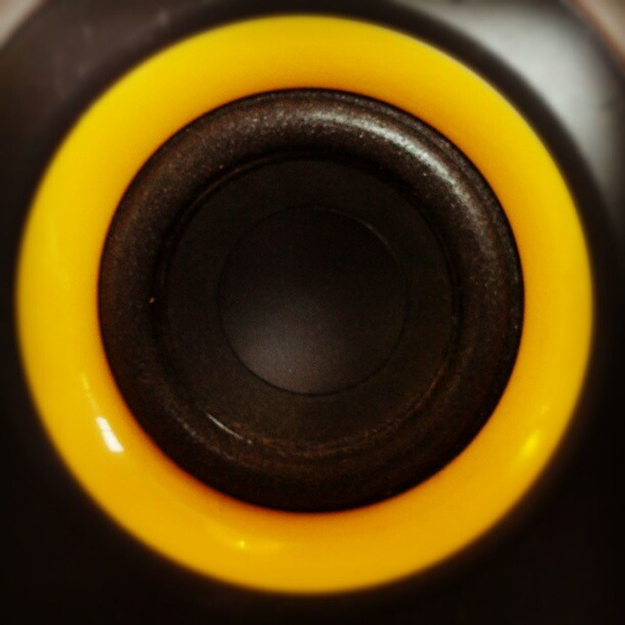 camera - photographic equipment, black color, close-up, yellow, sound recording equipment, photography themes, no people, technology, arts culture and entertainment, recording studio, studio shot, indoors, film industry, day
