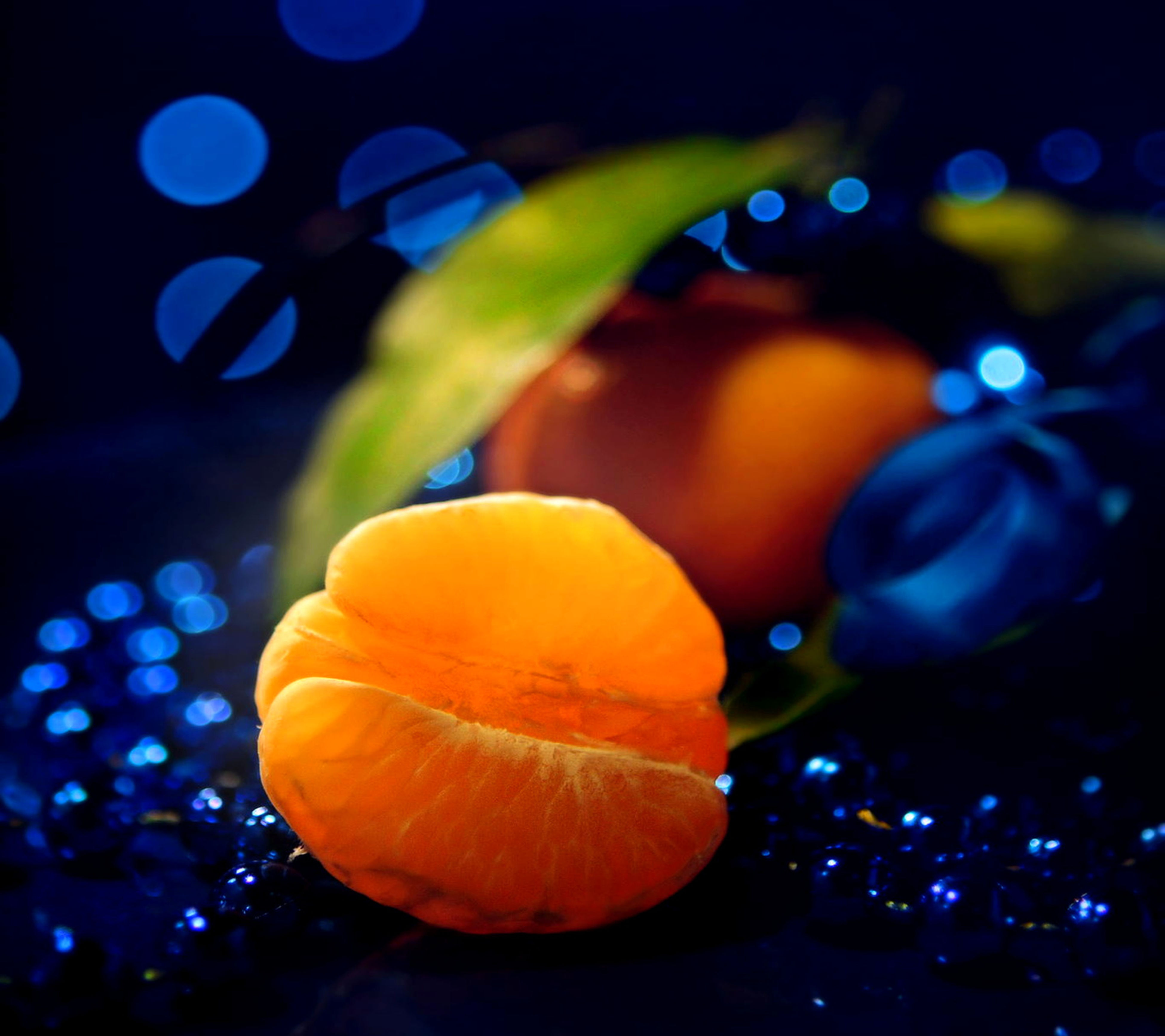 close-up, focus on foreground, orange color, indoors, multi colored, illuminated, yellow, no people, selective focus, glowing, night, blue, nature, freshness, beauty in nature, colorful, celebration, lens flare, decoration