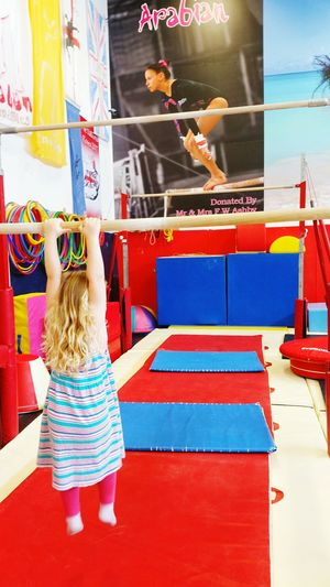 One Person Rear View Multi Colored Only Women Indoors  Flexibility Lifestyles Climbing Children Only Swing Hanging Gymnasts Gymnasium Full Length Aspire Aspirations Start Them Young