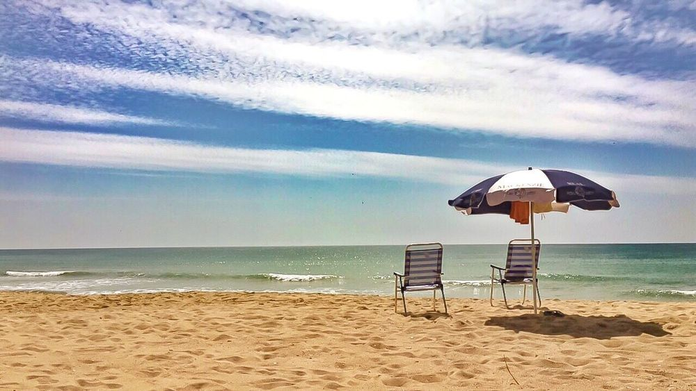 Beach time is back ... happy Sunday Dears 😘🏖 ____________________________________ Sea Beach Water Horizon Over Water Sky Protection Sand Nature Outdoors Cloud - Sky Day Tranquil Scene Beauty In Nature Sunlight Scenics Vacations Tranquility Beach Umbrella No People Lifeguard Hut Sun_collection, Sky_collection, Cloudporn, Skyporn Travel Destinations Portugal Algarve EyeEm Nature Lover
