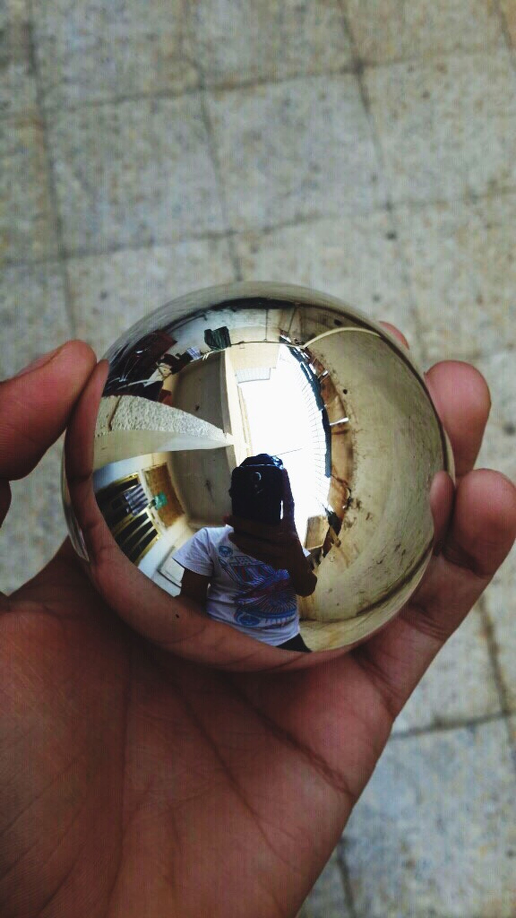 person, holding, part of, cropped, human finger, personal perspective, unrecognizable person, close-up, focus on foreground, lifestyles, leisure activity, circle, day, ring, men, high angle view, reflection