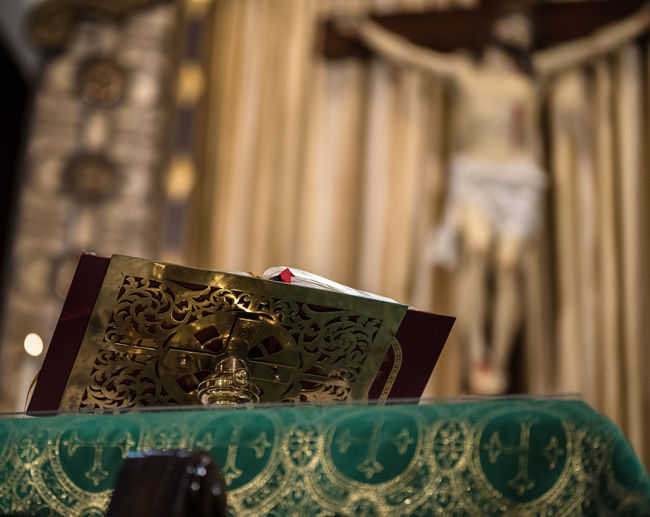 Bible Book Brass Catholic Church Close-up Day Depth Of Field Gold Green Indoors  Nikon D750 No People Photographyisthemuse Place Of Worship Quiet Places Religious  Religious Icons Sacred Places Sanctuary  Selective Focus Spirituality Statue