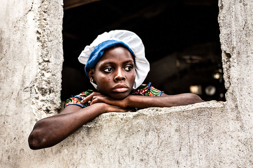 Girl observing the voodoo ceremony inside the convent | Ganvié, Southern, Benin. Africa Benin Ceremony Convent Day Girl Outdoors Portrait Portrait Of A Woman Real People The Photojournalist - 2017 EyeEm Awards Vaudou Voodoo Young Women