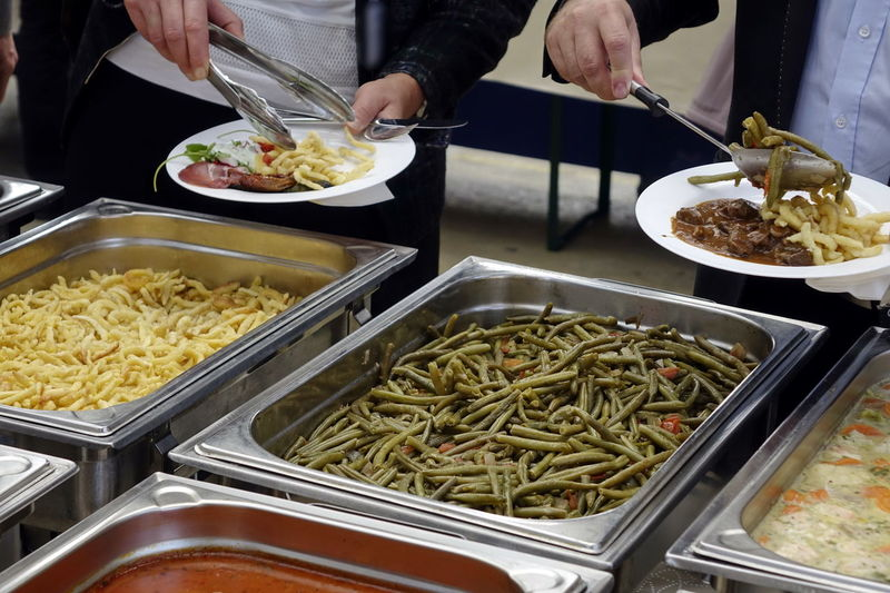 Catering Food Close-up Day Food Food And Drink Freshness Healthy Eating Holding Human Body Part Human Hand Indoors  Men Midsection One Person People Plate Preparation  Ready-to-eat Real People Serving Tongs