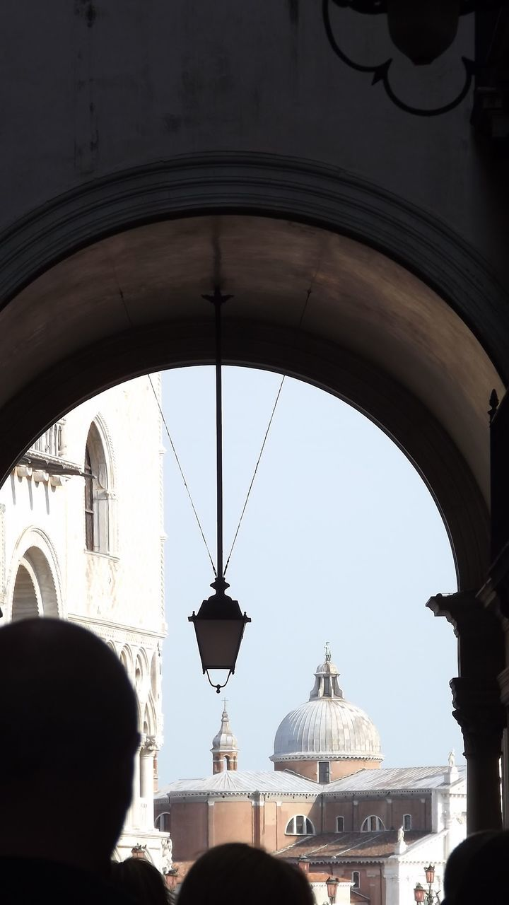 Low Angle View Of Silhouette People In Archway With Pendant Light At Piazza San Marco