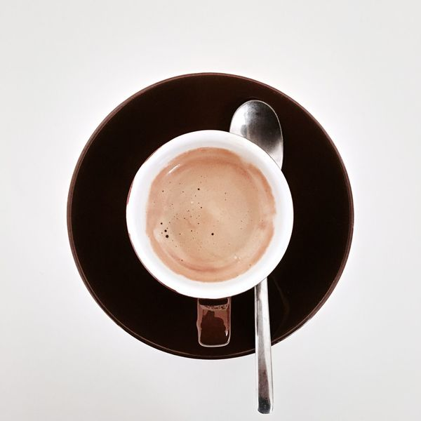 Coffee Cup Coffee - Drink Drink Refreshment Food And Drink Frothy Drink White Background Still Life Freshness Table Cup Studio Shot Directly Above No People High Angle View Saucer Cappuccino Beverage Indoors  Close-up