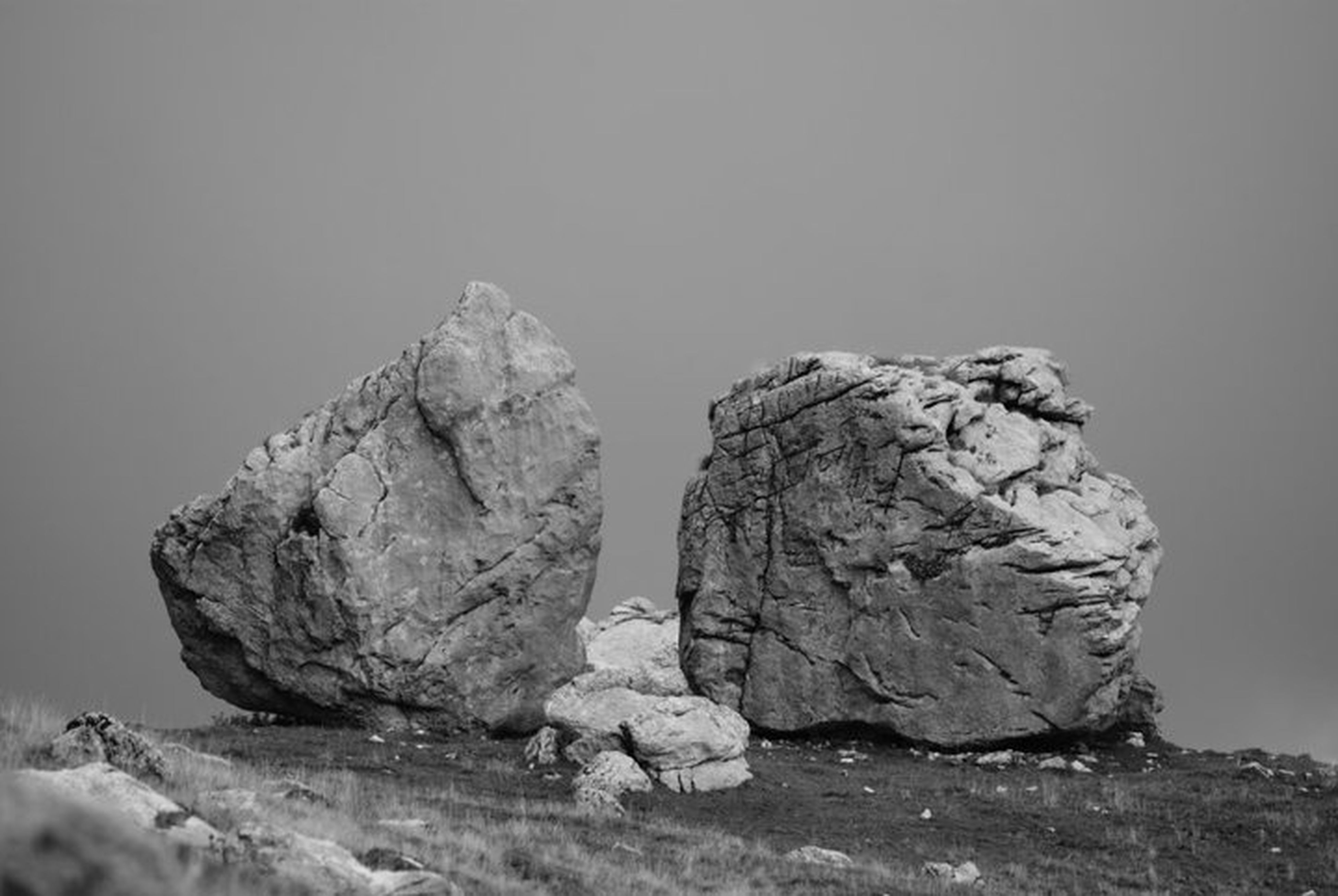 rock - object, rock formation, textured, rough, rock, tranquility, nature, clear sky, copy space, close-up, natural pattern, geology, tranquil scene, no people, beauty in nature, eroded, outdoors, focus on foreground, day, brown