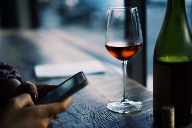 Red Wine // Technology Wineglass Wine Wireless Technology Refreshment Alcohol Connection Communication Food And Drink Drink Holding Focus On Foreground Personal Perspective Freshness