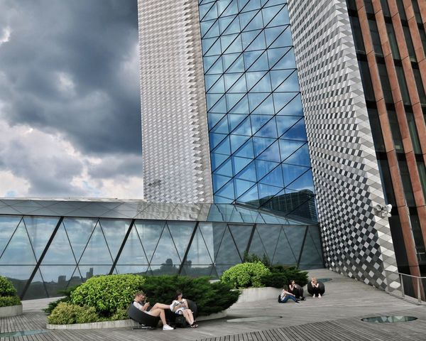 Architecture Modern Building Exterior City Day Sitting Real People Lithuania Vilnius Sky Capital City Vilnius City Vilnius, Lithuania Cityscape Travel Destinations Buildings Storm Cloud Relax Terasse