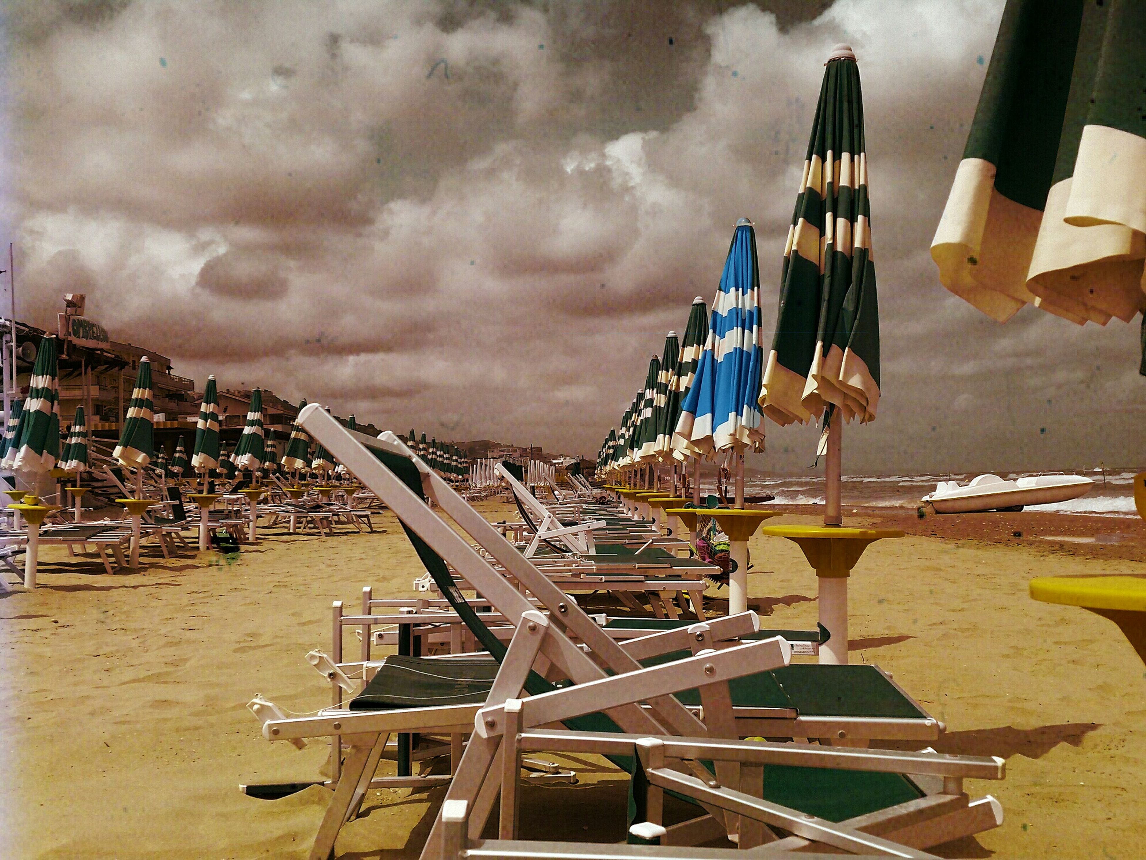 sky, cloud - sky, cloudy, beach, built structure, wood - material, sand, architecture, building exterior, outdoors, no people, cloud, industry, day, sea, absence, weather, construction site, metal, shore