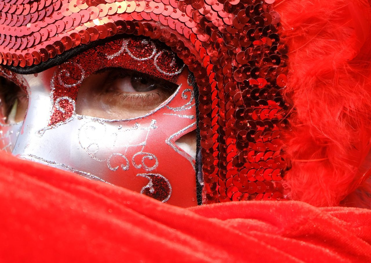 Red as the devil, hot as hell, pure as an angel, sweet as love. Red One Person Real People Close-up Women Day Outdoors Adults Only Venetian Mask People Adult Man Purim Costume EyeEmNewHere Blue Eyes Devil Red Costumes Carnaval Carnaval