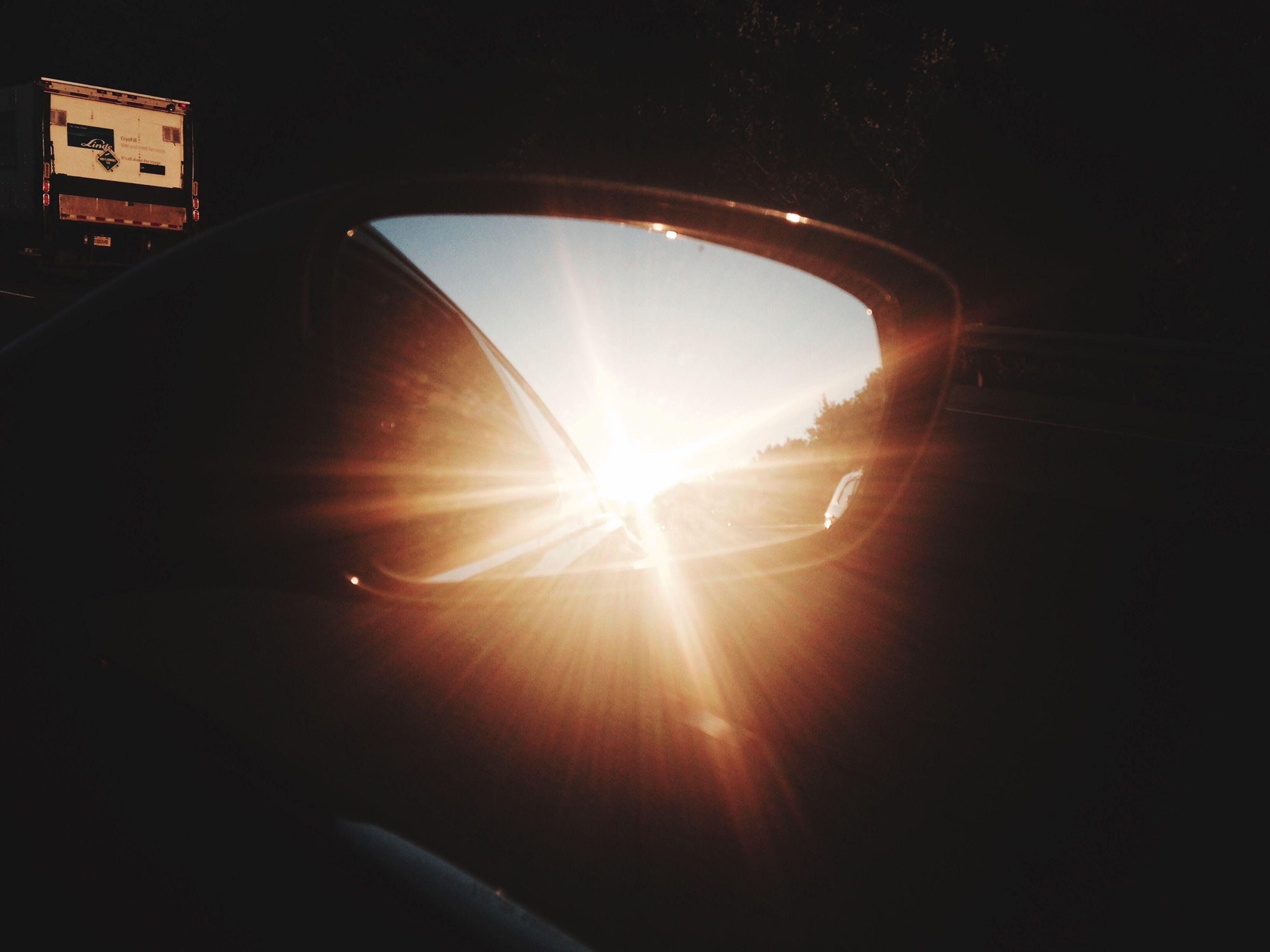 transportation, sun, sunlight, mode of transport, window, sunbeam, indoors, car, lens flare, reflection, land vehicle, glass - material, vehicle interior, silhouette, built structure, sunset, transparent, travel, architecture, dark