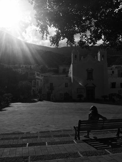 Tree Sunlight Sitting Architecture Built Structure Full Length Building Exterior Sunbeam Outdoors Sky One Person Day Adult People Messina Capo D'Orlando Black & White Isole Eolie Girl