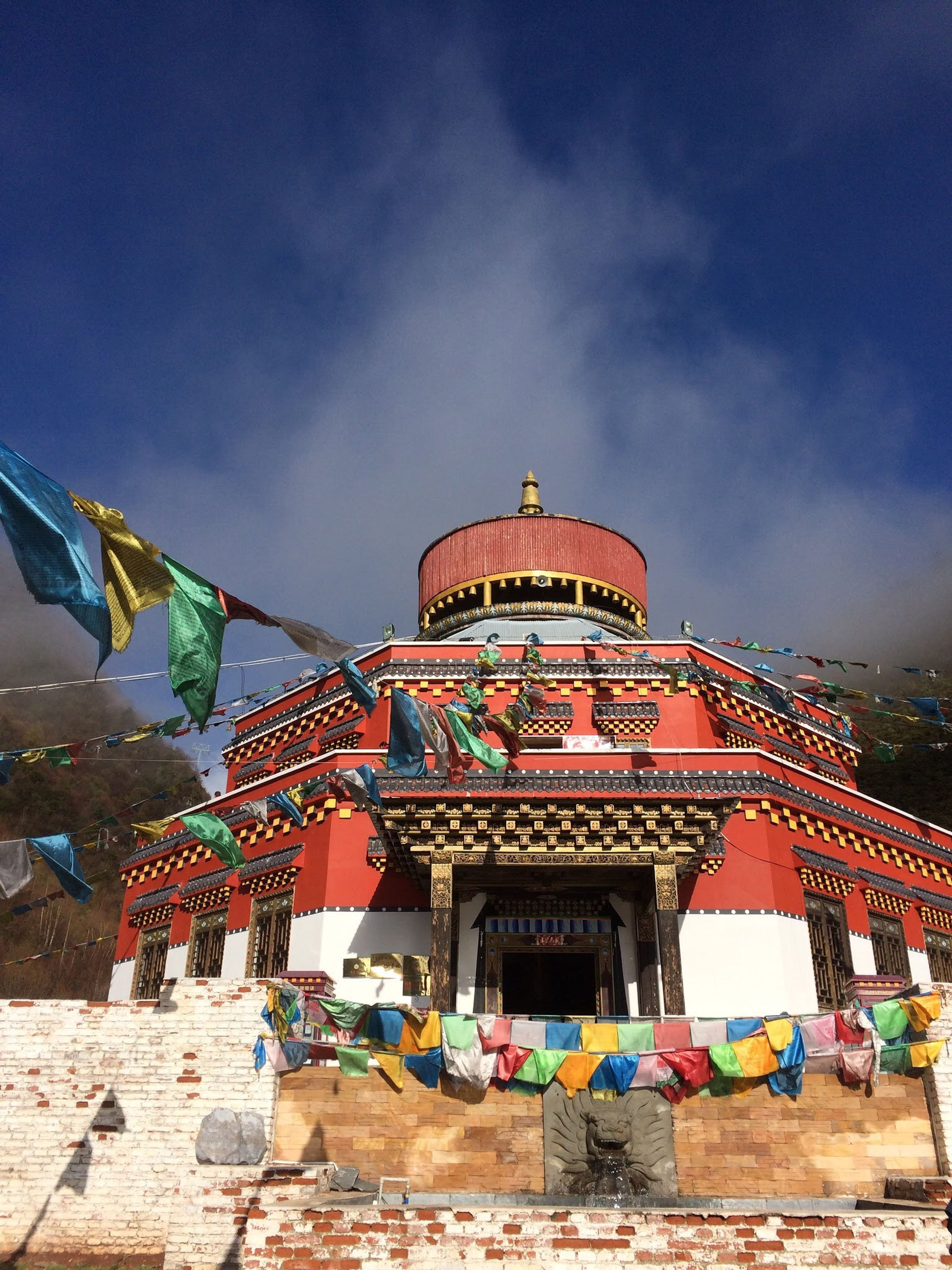 architecture, built structure, building exterior, sky, place of worship, religion, spirituality, cloud - sky, blue, roof, cloud, low angle view, temple - building, multi colored, travel destinations, outdoors, cultures, tradition, dome, famous place