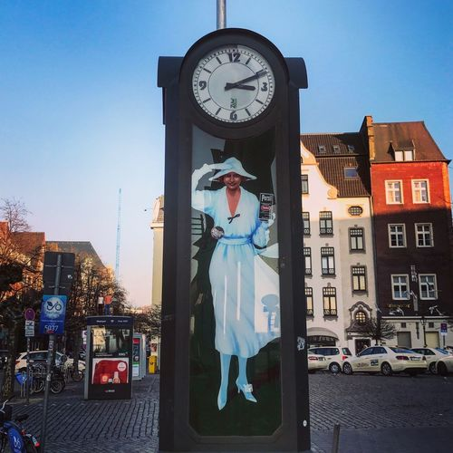 Henkel Architecture Building Exterior Built Structure City Clear Sky Clock Day Full Length Human Representation Lifestyles Outdoors Persil Real People Sculpture Sky Standing Statue Time