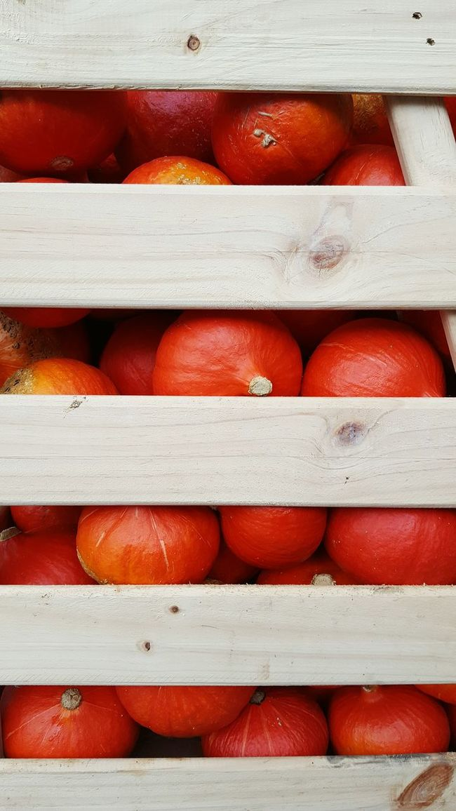 Crate filled with pumpkins No People Red Pumpkin Stack Pile Pumpkins Crate Large Group Of Objects Close Up Wood Fruit Health Healthy Food Healthy Eating Full Frame Backgrounds Stack Repetition Day Large Group Of Objects Red No People