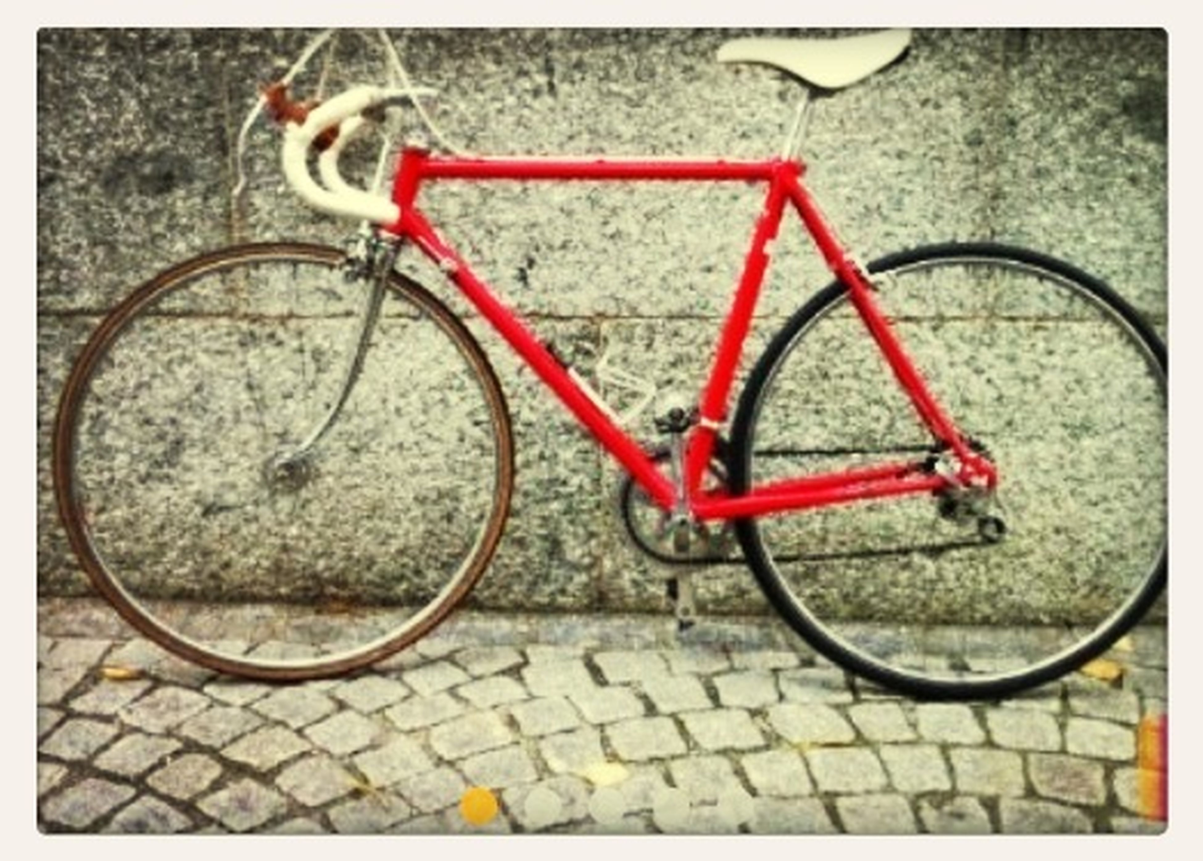 bicycle, transportation, transfer print, mode of transport, stationary, land vehicle, auto post production filter, wheel, parked, parking, metal, street, day, outdoors, no people, cobblestone, red, sidewalk, paving stone, safety