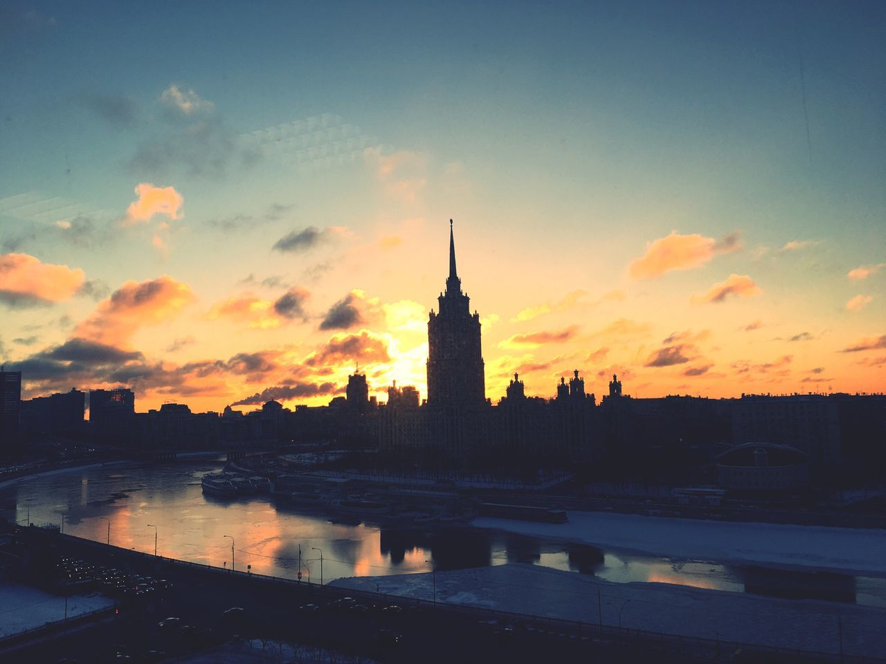 """Sunrise at Hotel """"Ukraine"""", Moscow, Russia Architecture Sky Built Structure Sunset City Morning Sky Sunrise_sunsets_aroundworld Building Exterior No People Cloud - Sky Silhouette Travel Destinations Outdoors Nature Water Beauty In Nature Cityscape Day"""