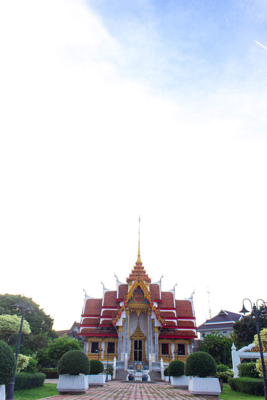 religion, architecture, place of worship, spirituality, built structure, building exterior, sky, no people, gold colored, clear sky, day, outdoors, travel destinations, tree