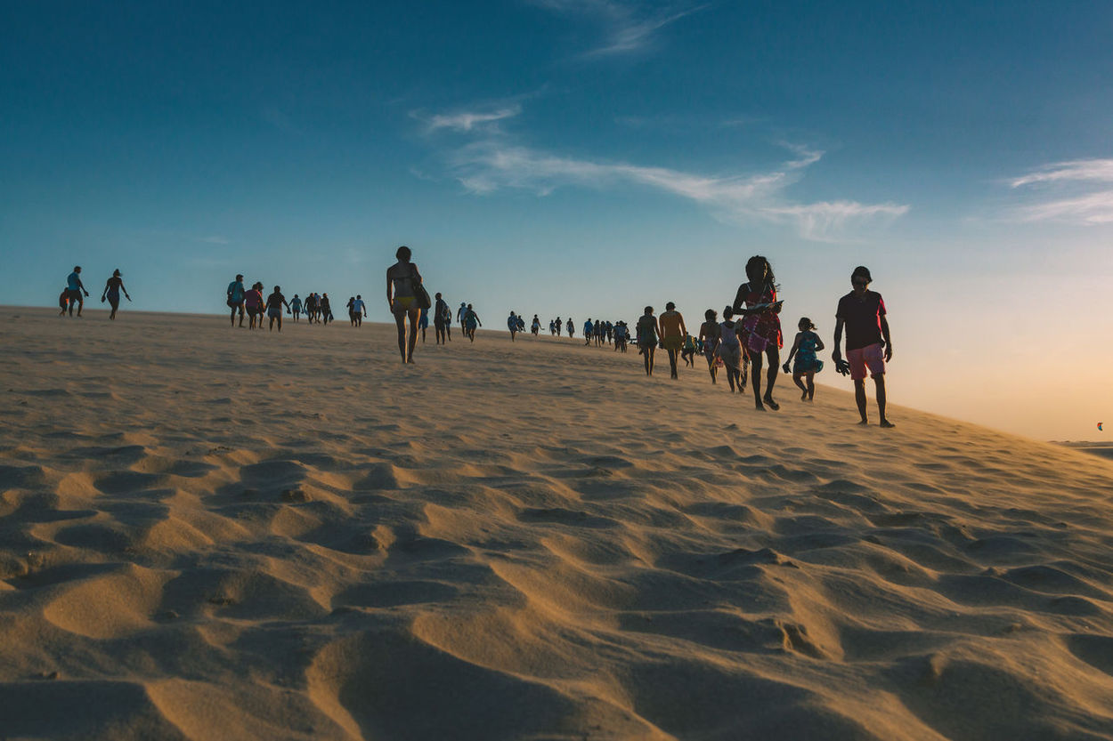 The famous dune in Jericoacoara. Adult Arid Climate Beach Beauty In Nature Day Desert Large Group Of People Leisure Activity Lifestyles Men Nature Outdoors People Real People Sand Sky Sky And Clouds Skyporn Sun Sunrise Sunset Travel Travel Destinations Vacations Women The Street Photographer - 2017 EyeEm Awards The Photojournalist - 2017 EyeEm Awards EyeEmNewHere Sommergefühle EyeEm Selects