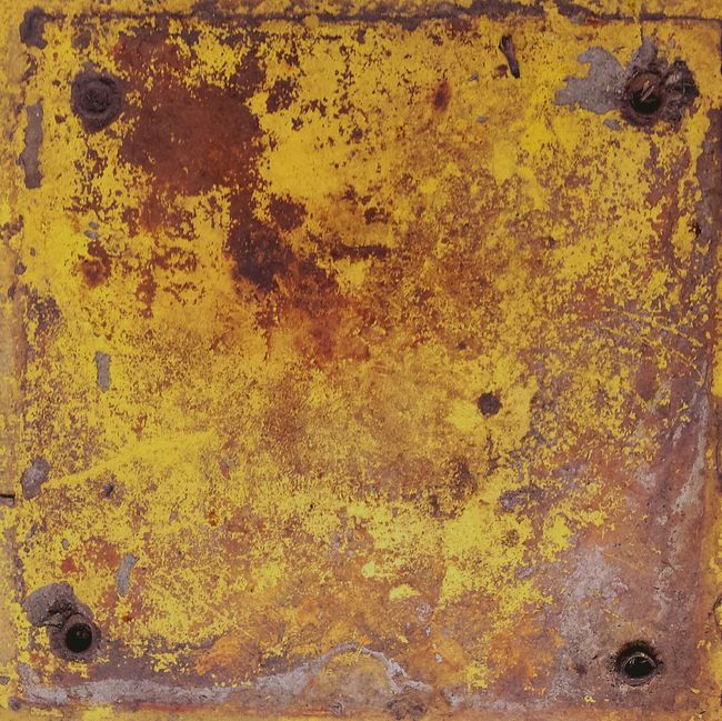 This is where a safety bollard was attached to the floor...before a forklift smashed into it Yellow Paint Decay Rustygoodness Closeup Taking Photos Urban Filter 4 Observing Textures And Surfaces On A Break Beautiful Day
