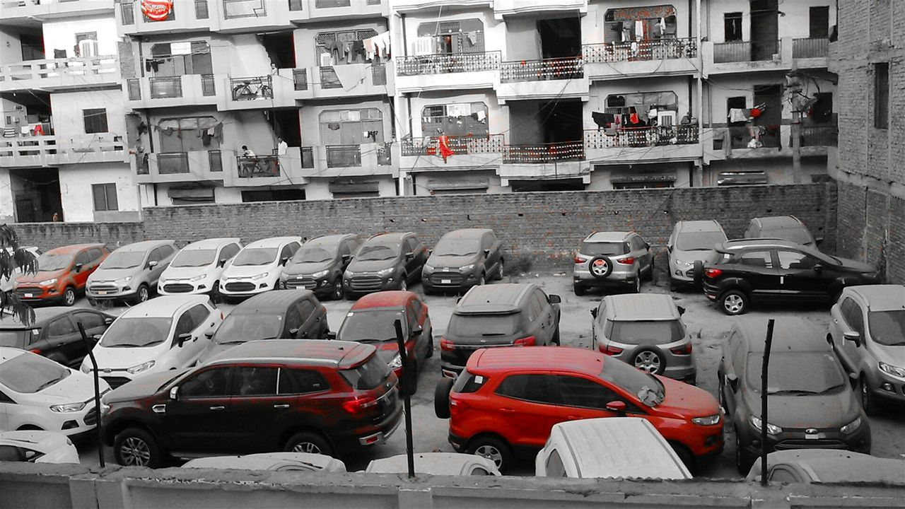 Contrast..! Picture shows both dark and bright side of a city.Effects of Urbanisation. A man can stock such a large amount of cars on the other side the people living in the houses shown in the photo can't even afford one. Contrast Society Dark And Bright India Hard Life Partialcolour Photography For Cause Dark Side Of Urban Life Urbanization Noida Smartphonephotography